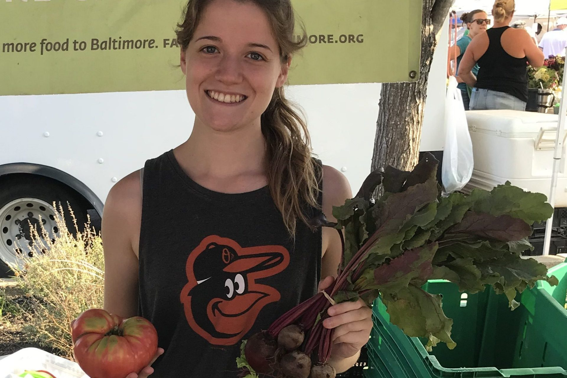 Lizzie with some beets and a tomato