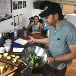 Chef Collin showing students how to cook brocolli