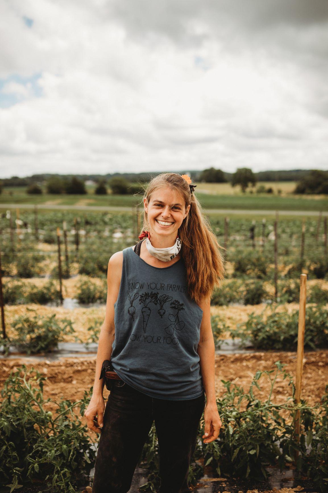 emma w tomatoes in field